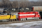 NS 9757 leads a mixed freight by the freshly repainted TRRA 2000 GP38-3 in Madison yard
