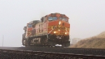 BNSF 4477 and two sisters lug a Z train up the hill.
