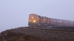 BNSF 7695 has its way with a WB grainer.