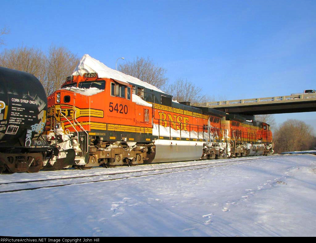 100129002 Eastbound BNSF freight waits in Wayzata Siding