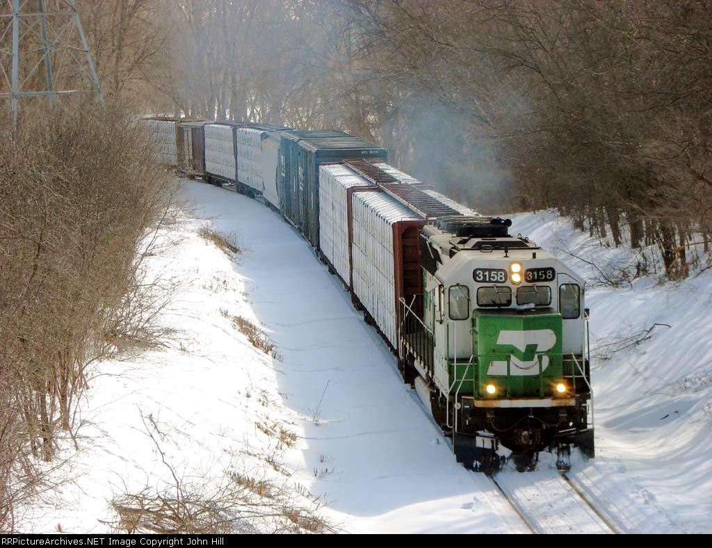 "100222004 BNSF ""Monti Local"" passing under Cedar Lake Road on Monticello Sub."