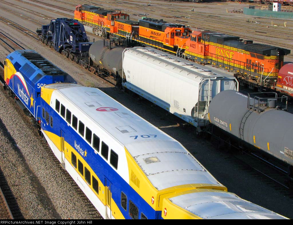 """100914374 Westbound """"Northstar"""" Commuter passes Schnabel CCRX 40010 At BNSF Northtown Yard 44th Ave"""