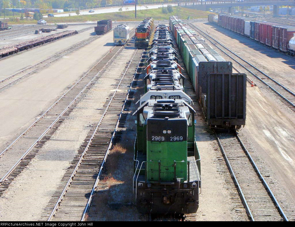 """101004049 DOTX 219 Plus Stored GP39V (And Other) Locos At BNSF Northtown """"T"""" Yard"""