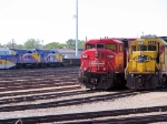 """100629020 Westbound Northstar commuter passes CP Widenose SD60M & BNSF Power at Northtown """"T"""" Yard"""
