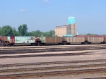 "100823035 BNSF ""Whale Car"" and other coal gons at Northtown ""T"" Yard"