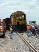 Spreading balast on new panel rail installed