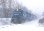 Southbound NHEN3X kicks up the snow on Conrail's River Line