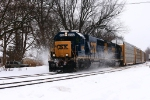 CSX Q262 with two old EMDs kicking snow at the crossing