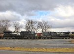 NS 9748 and 9890 facing off under a dramatic sky