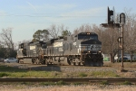 NS light power heading for the Navair district to pick up empty rock train?