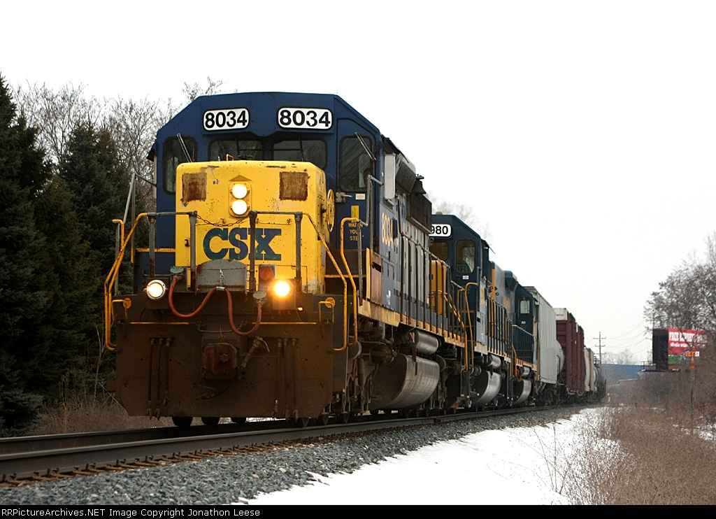 CSX 8034 leads a new slug set west on Q335
