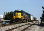 CSX 8872 leads Q327 west over the bridge
