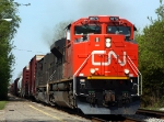 CN 8875 leads a CN freight east past the Amtrak depot