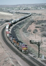 BNSF 565 leads a east bound trailer train out of town