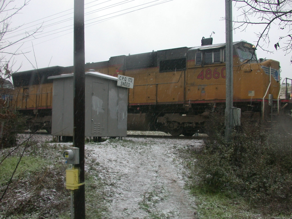 UP 4860, 23Feb2010 NB out of SNEED in the snow (It rarely snows in Austin)