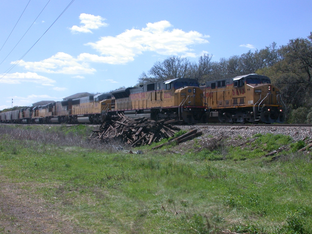 UP 6613  15Mar2010  UP 6613 NB with rock for ballast from Uvalde Texas for use in South Austin passes UP 8223 on the side in CENTEX