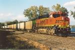 Loaded coal train works east