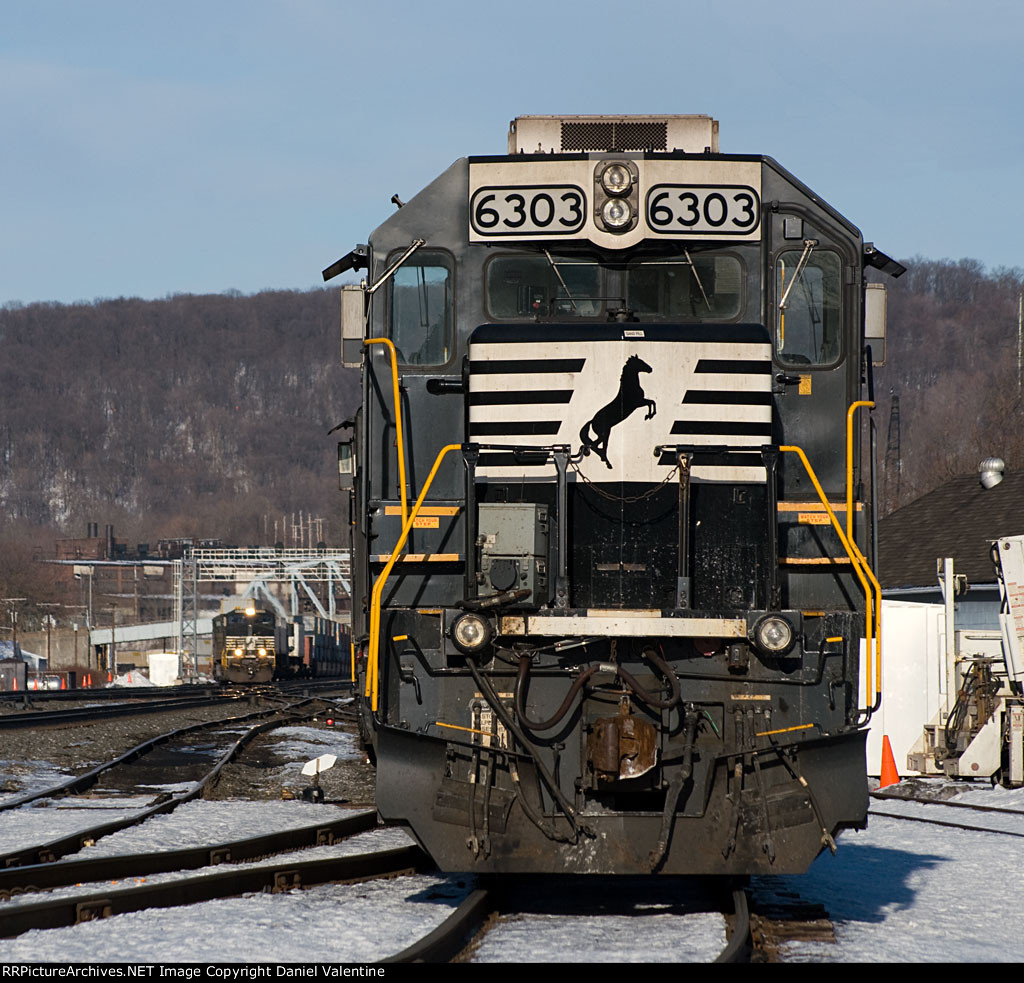 02-11-2011: NS 6303 waits on track 6 while 23W is going 3 to 2 at CP C.