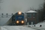 Through fog and freezing drizzle, NS534 brings its train to the top