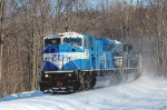 7210 leads a train