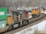 BNSF 4900 East, loaded grain train meets the BNSF 705 West