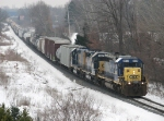 CSX 8034 and a slug set power Q335-23 west as they near Seymour