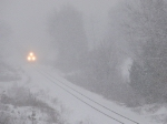 The lights of CSX 797 pierce the thick snow as Q335 approaches