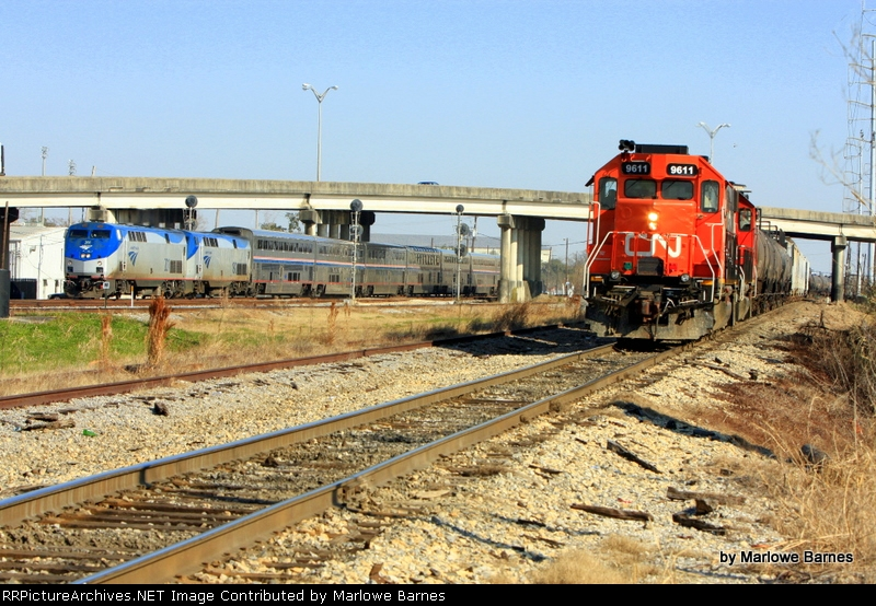 CN 9611 works the May Yard as the Sunset Ltd. begins its westward trek