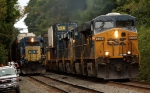 CSX 8709 still being worked on is overtaken by westbound container