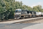 NS 7618 and NS 9788 Fly past a railroad Crossing