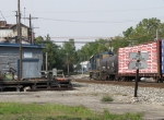 2517 pulls down the Industrial Track for headroom as D708 rolls by the MOW building and block limits