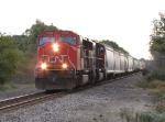 CN 5606 & 5661 roll towards the US-131 crossing with a late day eastbound