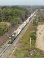 The 89 cars of Q334-07 stretch out behind CSX 8113 & 7776