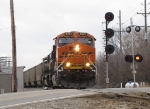 BNSF 6373 leads N954 out of the siding past the southward signal