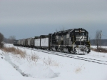 NS 3068 & 3069 roll east through the siding with B05
