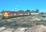 A westbound Rock Island freight at the Santa Fe/GM&O diamond