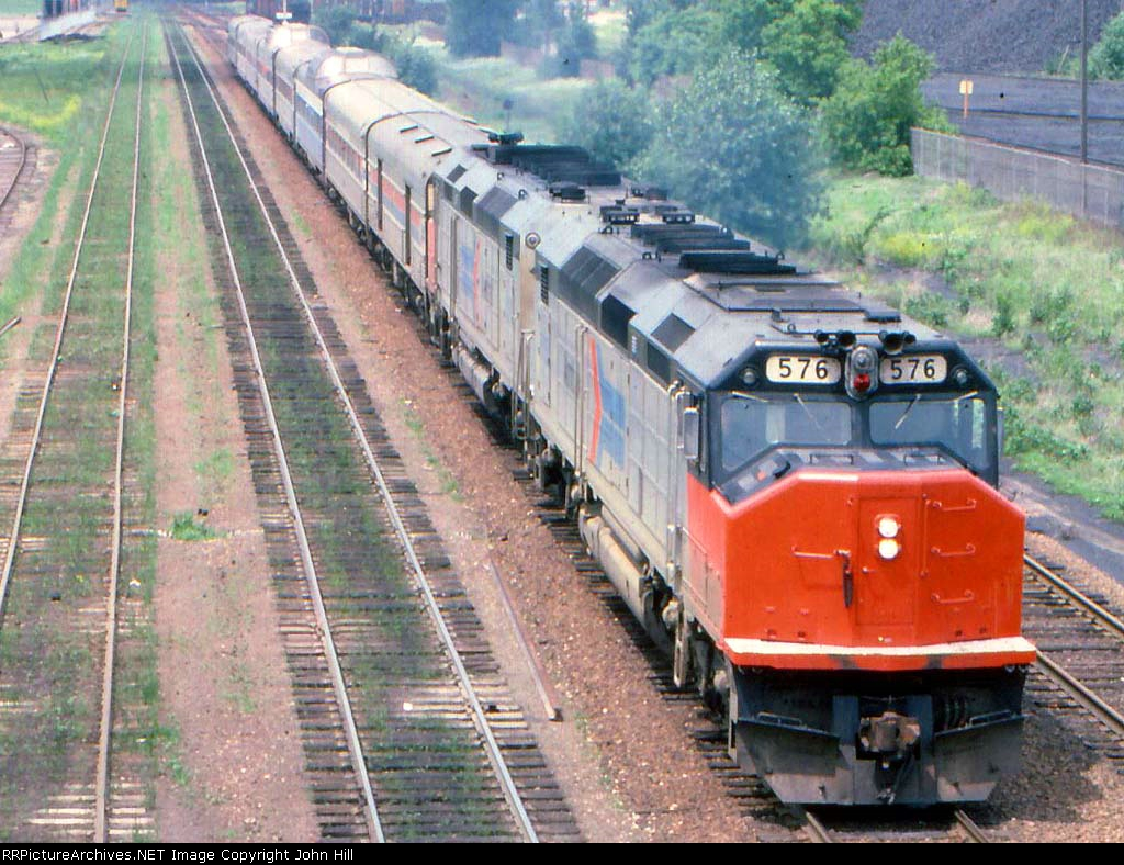 1000-05a Eastbound Amtrak North Coast Hiawatha passing Koppers Coke
