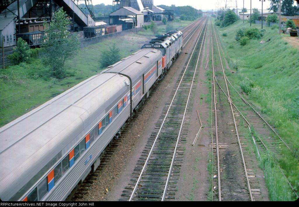 1000-07 Eastbound Amtrak North Coast Hiawatha passing Koppers Coke