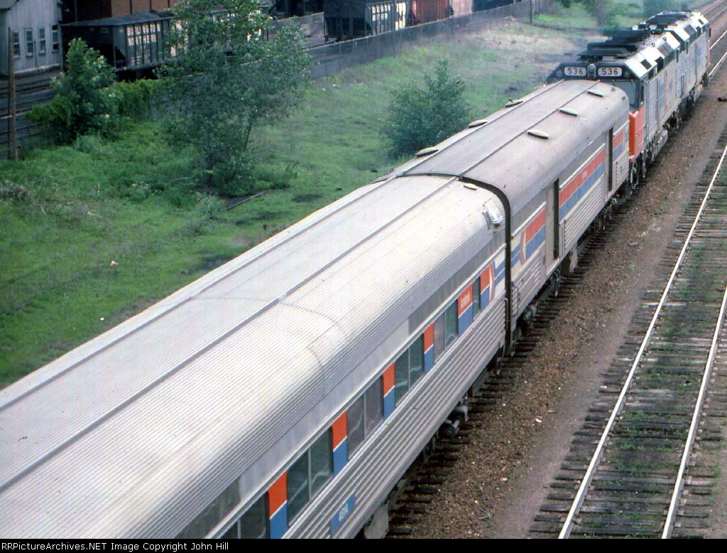 1000-07a Eastbound Amtrak North Coast Hiawatha passing Koppers Coke