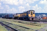 1001-32 C&NW transfer on MILW mains passes St. Paul Union Depot (SPUD)