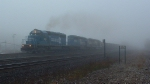 NS 3361 leads a loaded coal drag in heavy fog
