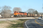 BNSF 6322 passes a Caprice