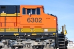 BNSF 6302 side shot as she rolls into Y pulling a eastbound loaded coal train towards Edgemont, S.D.