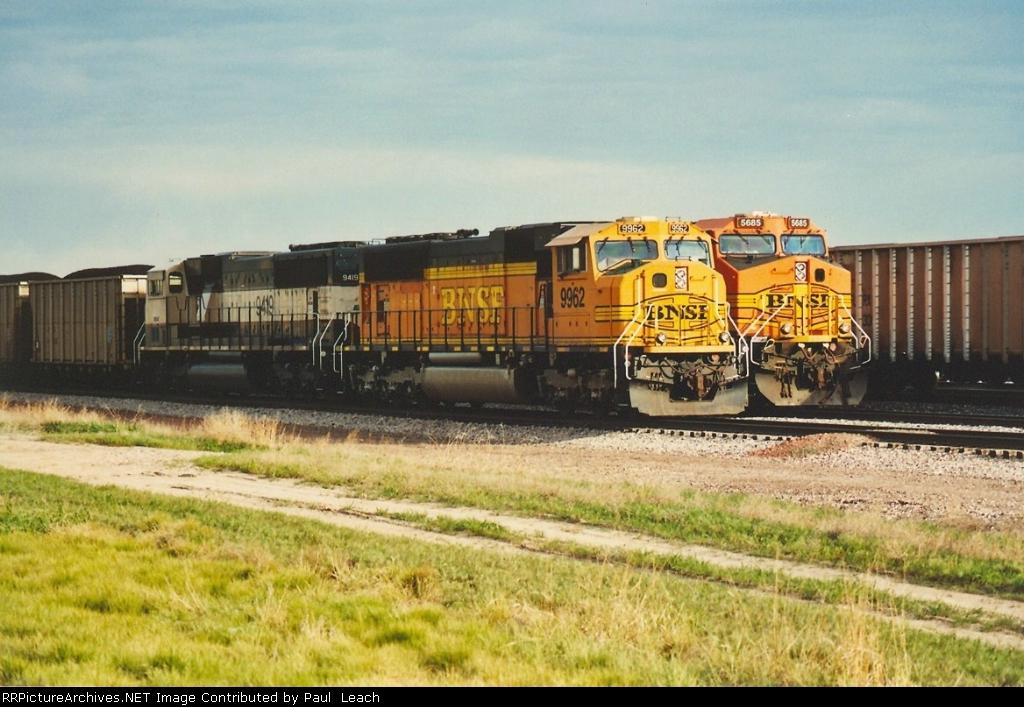 Loaded coal train side by side