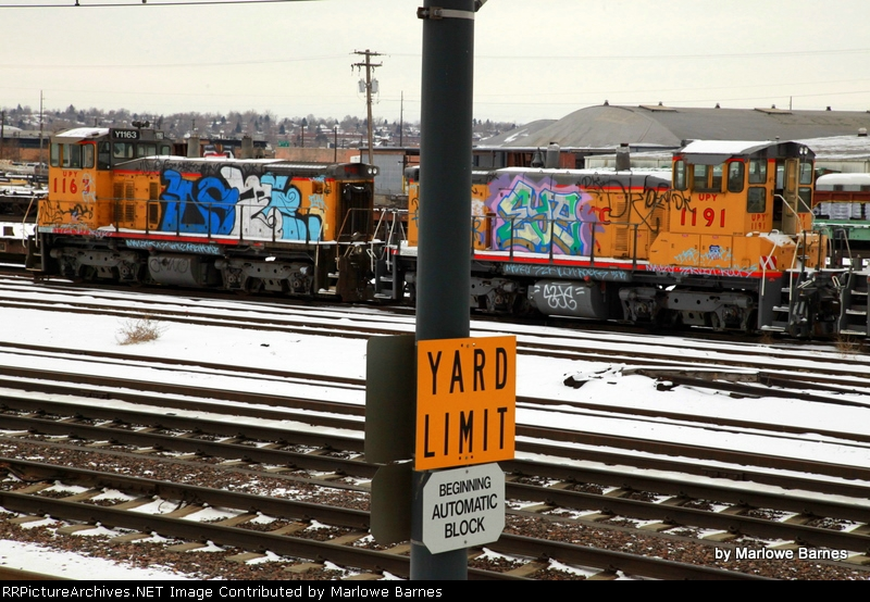 UPY 1163 and 1191 in storage serving as grafitti platforms
