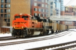 BNSF 9393 ushers one of many unit trains of black gold that traverse through the city