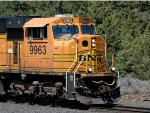 BNSF 9963 with flags flying for 4th of July