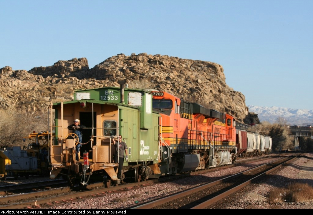 BNSFs Victorville Local Heads Back to the Yard with a BN Caboose.