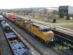 NS train 225 with UP 7912 takes the green past NS train and CSX train