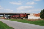AM 60 and three other C420s head south past bridge construction